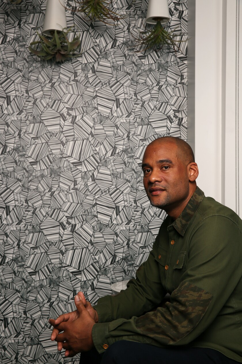 Karim Webb poses for a portrait at his offices on November 22, 2019