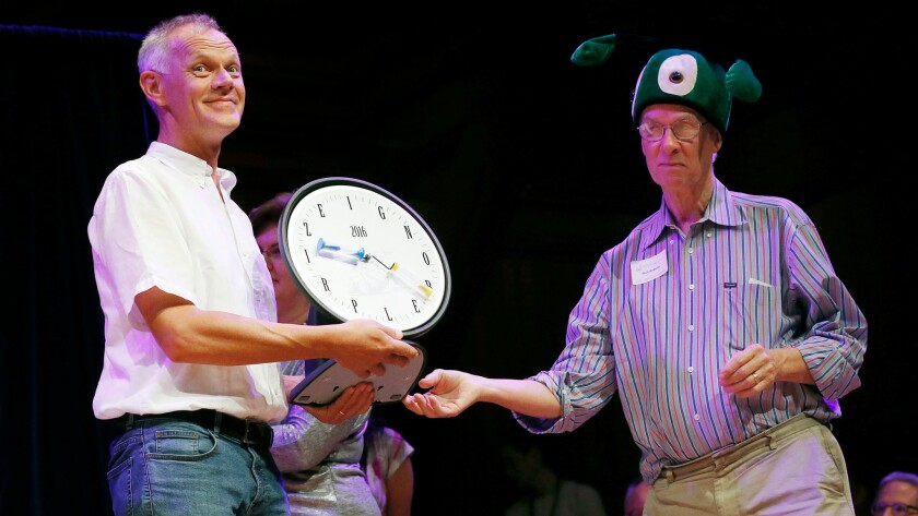Andreas Sprenger, left, accepts the Ig Nobel in medicine from Nobel laureate Richard Roberts for his research showing that you can sometimes relieve an itch on your right arm by scratching your left arm.