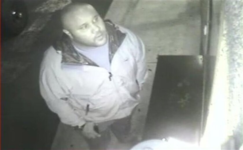 ADDS DATE VIDEO WAS TAKEN - This image provided by the Irvine Police Department shows Christopher Dorner from Jan. 28, 2013 surveillance video at an Orange County, Calif., hotel. More than 100 officers, including SWAT teams, were driven in glass-enclosed snow machines and armored personnel carriers