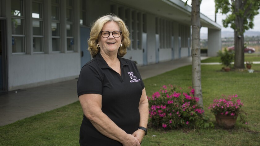 Debbie Davis is retiring after 15 years serving as the principal of Back Bay High School in Costa Mesa. Under her leadership, school hours increased from three to five and graduation and attendance rates have improved.