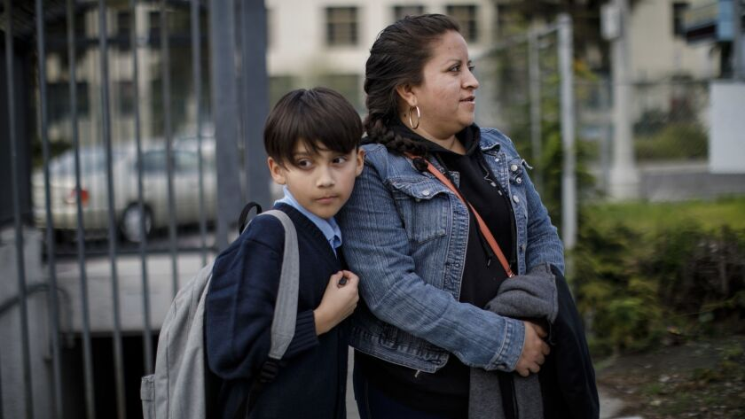 Angelica Valdovinos, 33, walks home with her son, Merwinn Rojas, 11, after school at Foshay Learning Center in Los Angeles.