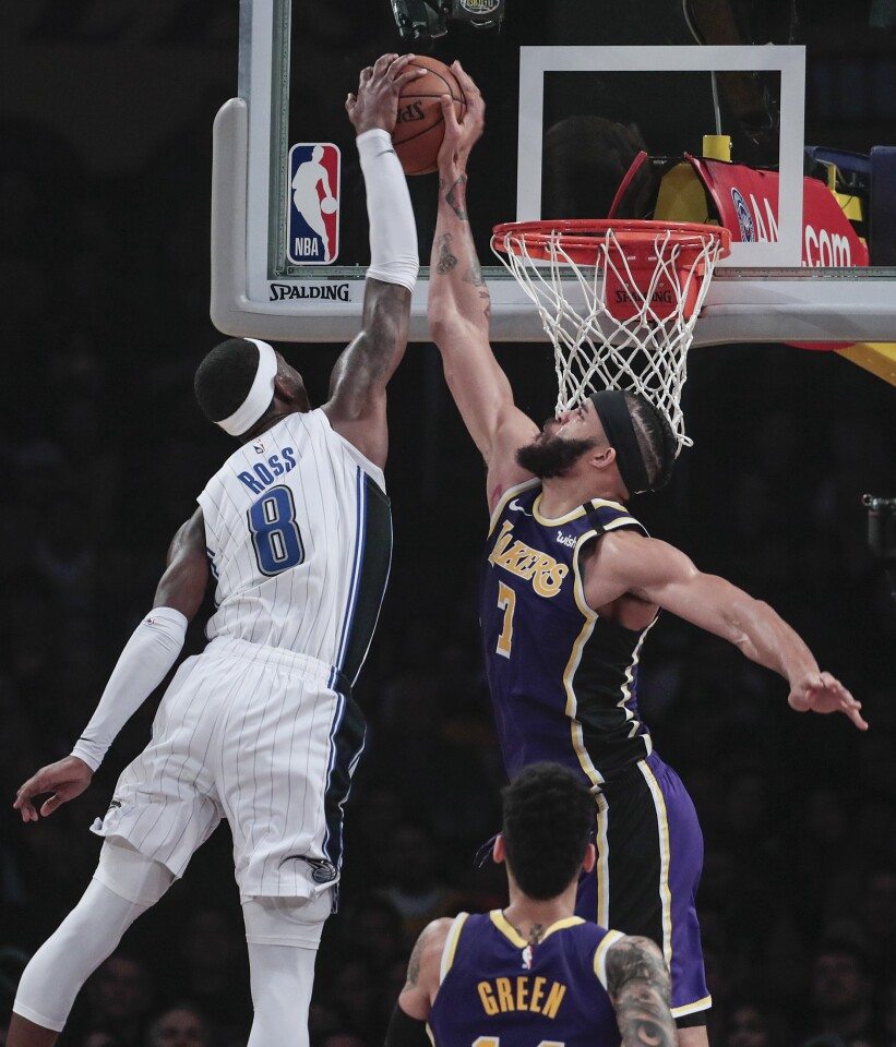 LOS ANGELES, CA, WEDNESDAY, JANUARY 15, 2020 - Los Angeles Lakers center JaVale McGee (7) stuffs Orlando Magic guard Terrence Ross (8) late in the first half at Staples Center. (Robert Gauthier/Los Angeles Times)