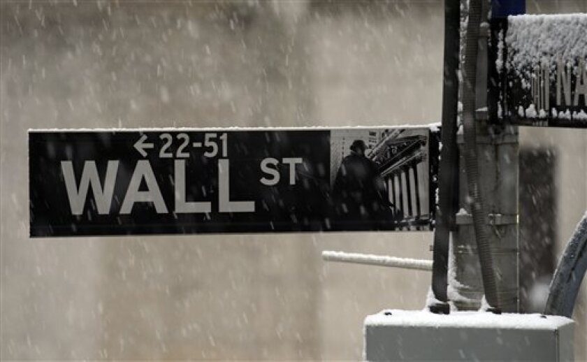 FILE - In this Dec. 31, 2009 file photo, snow falls outside the New York Stock Exchange in New York. Stocks retreated modestly early Wednesday, Feb. 3, 2010, following a mixed batch of earnings.(AP Photo/Henny Ray Abrams, file)