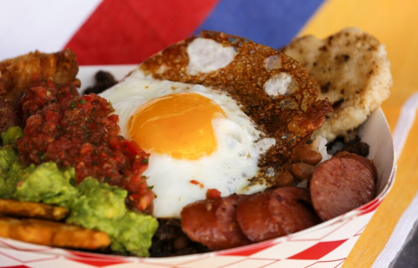 The Paisa Bowl is a protein-packed serving of pork belly, steak, sausage, beans, white rice, plantains, avocado and an arepa topped with a fried egg, from the Cali Fresh food truck.
