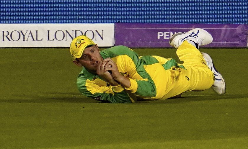 Australia's Josh Hazlewood reacts after taking the catch to dismiss England's Jonny Bairstow during the first ODI cricket match between England and Australia, at Old Trafford in Manchester, England, Friday, Sept. 11, 2020. (AP Photo/Jon Super, Pool)