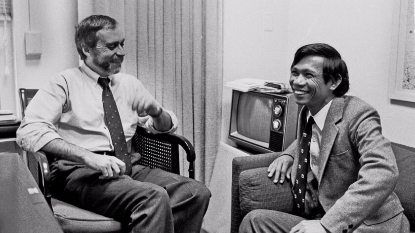 Sydney Schanberg, left, with Dith Pran at the New York Times office in 1980.