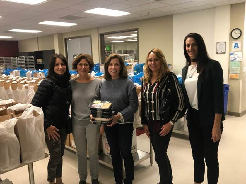 """A site visit to Mama's Kitchen prior to the COVID-19 lockdown. Mama's Kitchen will be receiving $50,000 for its """"Cancer Nutrition Program."""" (L-R) RSF Woman's Fund members Allison Williams, Mary Consalvi, Judy Oliphant, Site Visit Leader Danya Pineda, and Mama's Kitchen Director."""