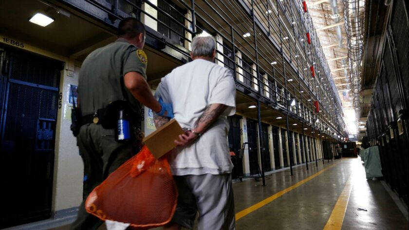 SAN QUENTIN, CALIF. -- TUESDAY, AUGUST 16, 2016: A death row inmate is escorted back to his East Blo