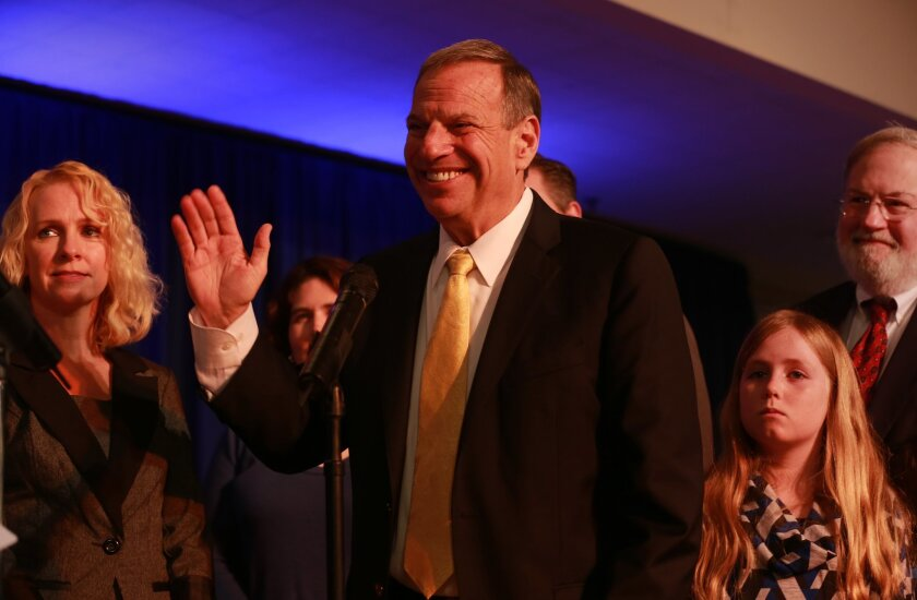Bob Filner is sworn in as San Diego's new mayor Monday, along with new and returning council members. The audience packed the Balboa Park Club for the ceremony. At left is Filner's fiance Bronwyn Ingram and at right is his granddaughter Maddie Filner, 9, and his brother, Bernie Filner.