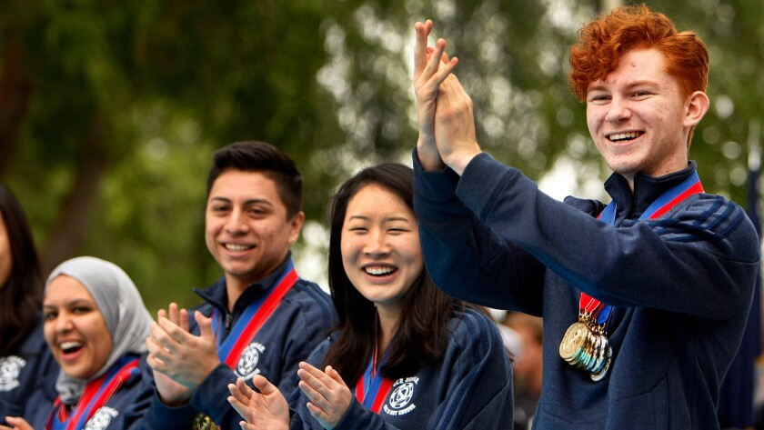 The team from El Camino Real Charter High School celebrates on its way to winning the 2014 national Academic Decathlon. The school was regarded as well run before and after becoming a charter, but faces controversies over health benefits and spending.