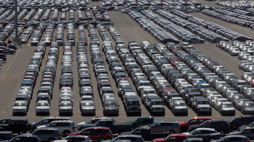 Thousands of cars wait to be distributed at the National City Marine Terminal where Pasha Automotive Services takes in and ships out cars via land sea and rail.