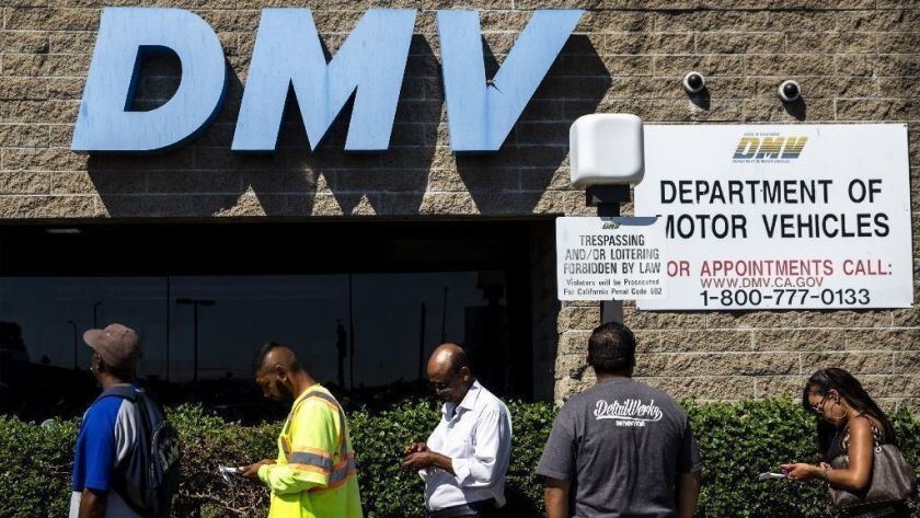 A line of people waits for help outside a California Department of Motor Vehicles office in south Los Angeles on Tuesday, Aug. 7, 2018.
