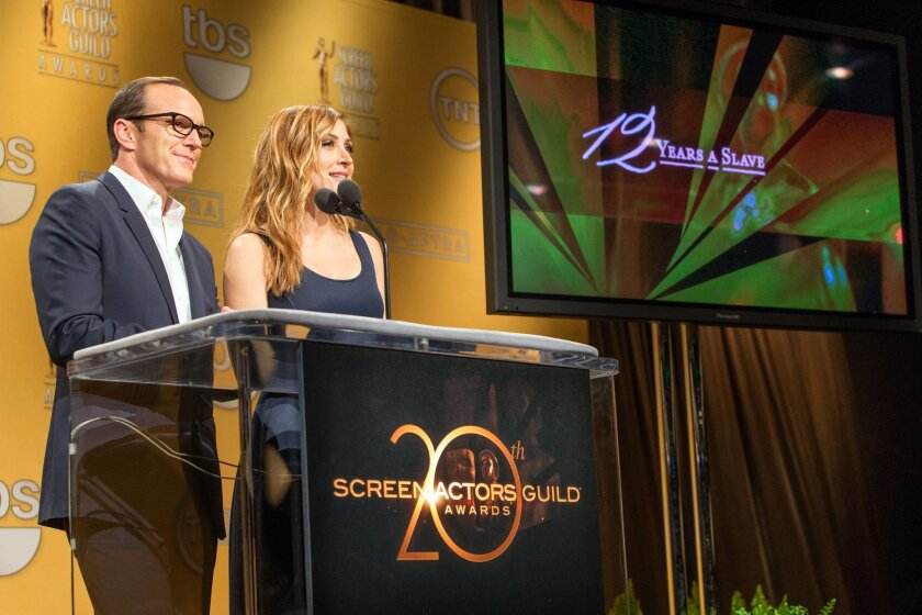 Clark Gregg and SAG Awards Social Media Ambassador /Actress Sasha Alexander announce the nominees for the 20th Annual Screen Actors Guild Awards at the Pacific Design Center on Wednesday December 11, 2013 in Los Angeles. (Photo by Paul A. Hebert/Invision/AP)