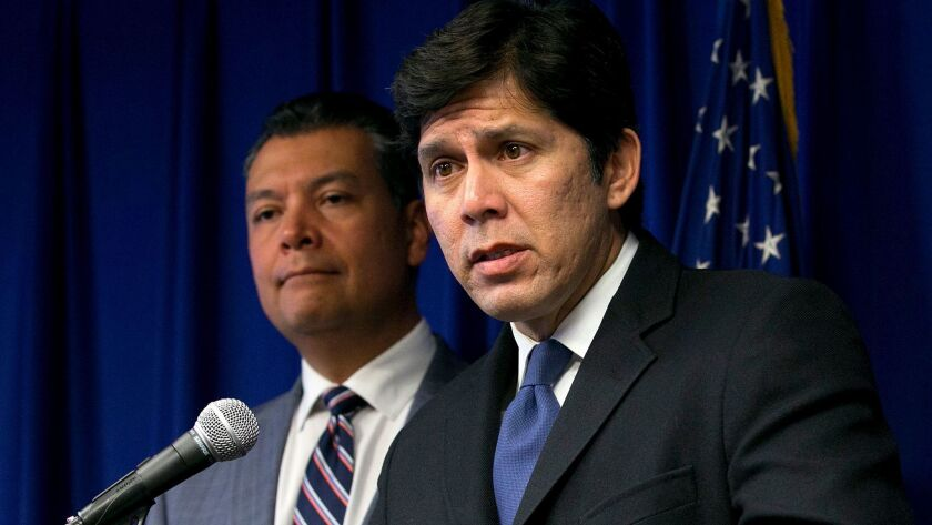 State Senate President Pro Tem Kevin de Leon (D-Los Angeles), right, backed by Secretary of State Alex Padilla, blasted the president's decision to cancel the Deferred Action for Childhood Arrivals program at a news conference on Sept. 5.