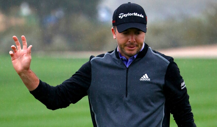 Martin Laird acknowledges the fans at the ninth green during the second round of the Phoenix Open on Friday.