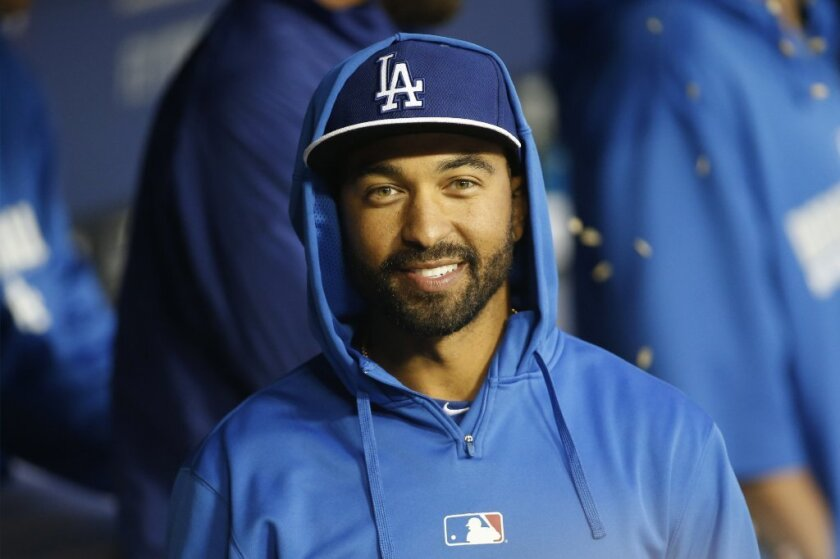Dodgers' Matt Kemp smiles in the dugout before an exhibition against the Angels on March 28.