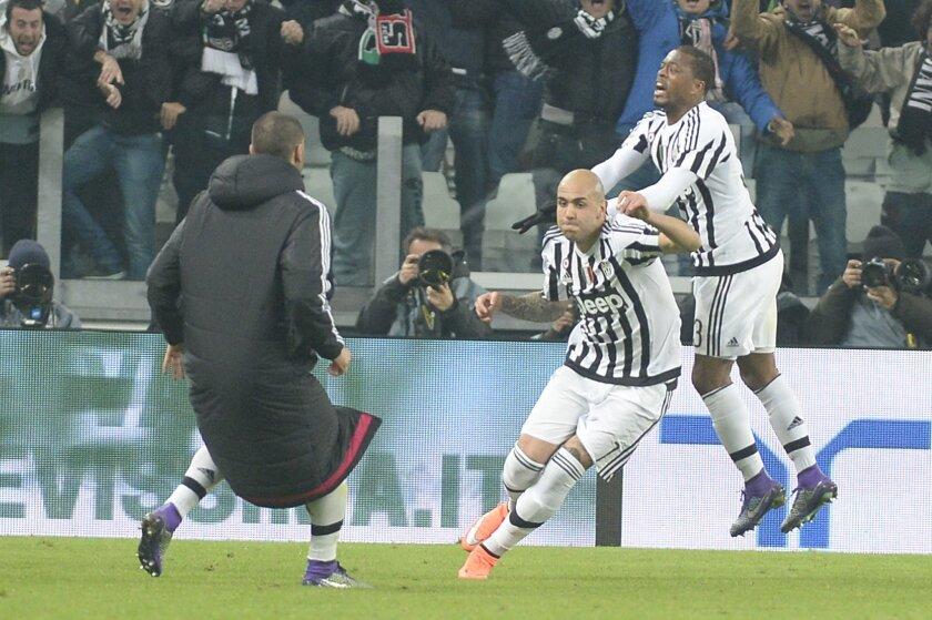 Juventus' Simone Zaza celebrates after scoring during a Serie A soccer match between Juventus and Napoli at the Juventus stadium, in Turin, Italy, Saturday, Feb. 13, 2016. (AP Photo/Massimo Pinca)