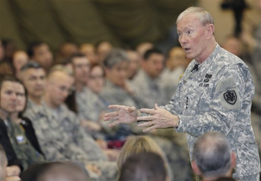Gen. Martin Dempsey, chairman of the U.S. Joint Chiefs of Staff, gives remarks for soldiers of the U.S. Armed Forces in Japan at Yokota Air Base on the outskirts of Tokyo Thursday, April 25, 2013. Dempsey is in Japan as part of his trip to Asia. (AP Photo/Shizuo Kambayashi)