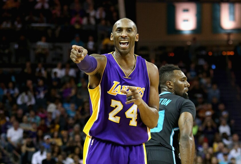 Kobe Bryant points and yells after a play against the Hornets in Charlotte, N.C., on Dec. 28.