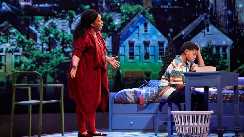 "L-R: Kimberly H?bert Gregory and Cedric Joe in the World Premiere of ""Black Super Hero Magic Mama"" a"