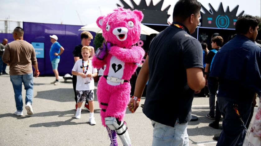 LOS ANGELES, CA-JUNE 15, 2019: The Cuddle Team Leader interacts with people during a summer block pa