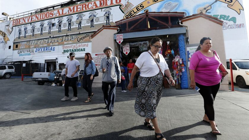 BOYLE HEIGHTS, CA-APRIL 6, 2017: Shoppers exit the El Mercado in Boyle Heights on April 6, 2017.