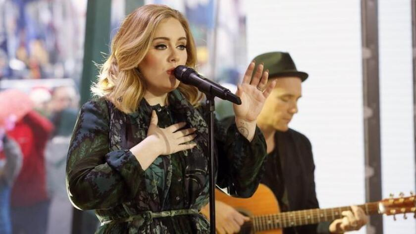 """FILE - In this Wednesday, Nov. 25, 2015, file photo, released by NBC, Adele performs on the """"Today"""" show to promote her latest release, """"25."""" Apple announced Wednesday, Dec. 9, 2015, that Adele's """"25"""" is the best-selling album on iTunes for 2015. (Heidi Gutman/NBC via AP, File) (/ The Associated Press)"""