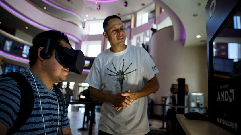 Williams Avelar tries virtual reality at Regal L.A. Live.