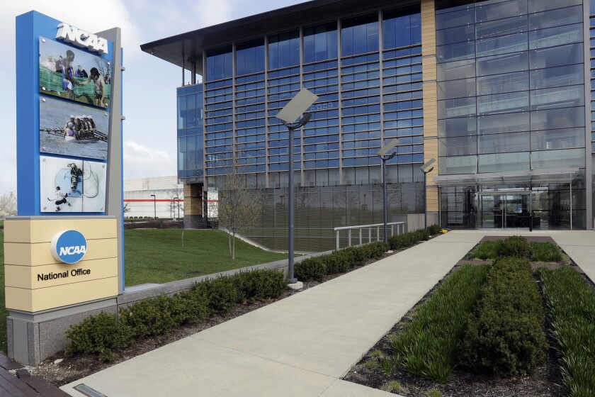 """FILE - This is an April 25, 2018, file photo, showing NCAA headquarters in Indianapolis. The NCAA Board of Governors took the first step Tuesday, Oct. 29, 2019, toward allowing athletes to cash in on their fame, voting unanimously to clear the way for the amateur athletes to """"benefit from the use of their name, image and likeness."""" The United States' largest governing body for college athletics realized that it """"must embrace change to provide the best possible experience for college athletes,"""" the board said in a news release issued after the vote at Emory University in Atlanta. (AP Photo/Darron Cummings, File)"""
