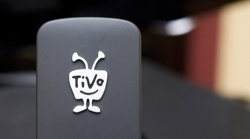 Digital TV listing company Rovi is buying TiVo in a cash-and-stock deal valued at about $1.1 billion. Rovi Corp. said Friday, April 29, 2016 that it will pay $10.70 in cash and stock for each TiVo Inc. share. Rovi will pay $2.75 per share in cash, or about $277 million. The rest, $7.95 per share, will be paid in stock.