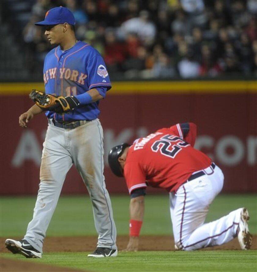 New York Mets shortstop Ruben Tejada, (11) walks away from Atlanta Braves' Juan Francisco (25) after he was tagged out at second base during the third inning of a baseball game, Friday, May 3, 2013, in Atlanta. (AP Photo/John Amis)