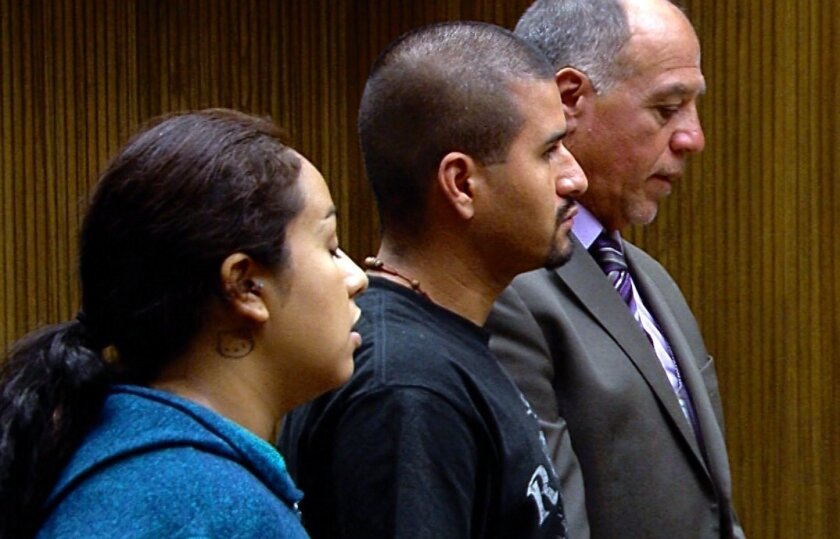 EL CAJON -- Jessica Quezada, 22 (left) and Israel Soto, 30 (right), both of whom are accused of leaving their 4-month-old son in a car overnight, pleaded not guilty Tuesday to felony child endangerment. The child died later at a hospital.