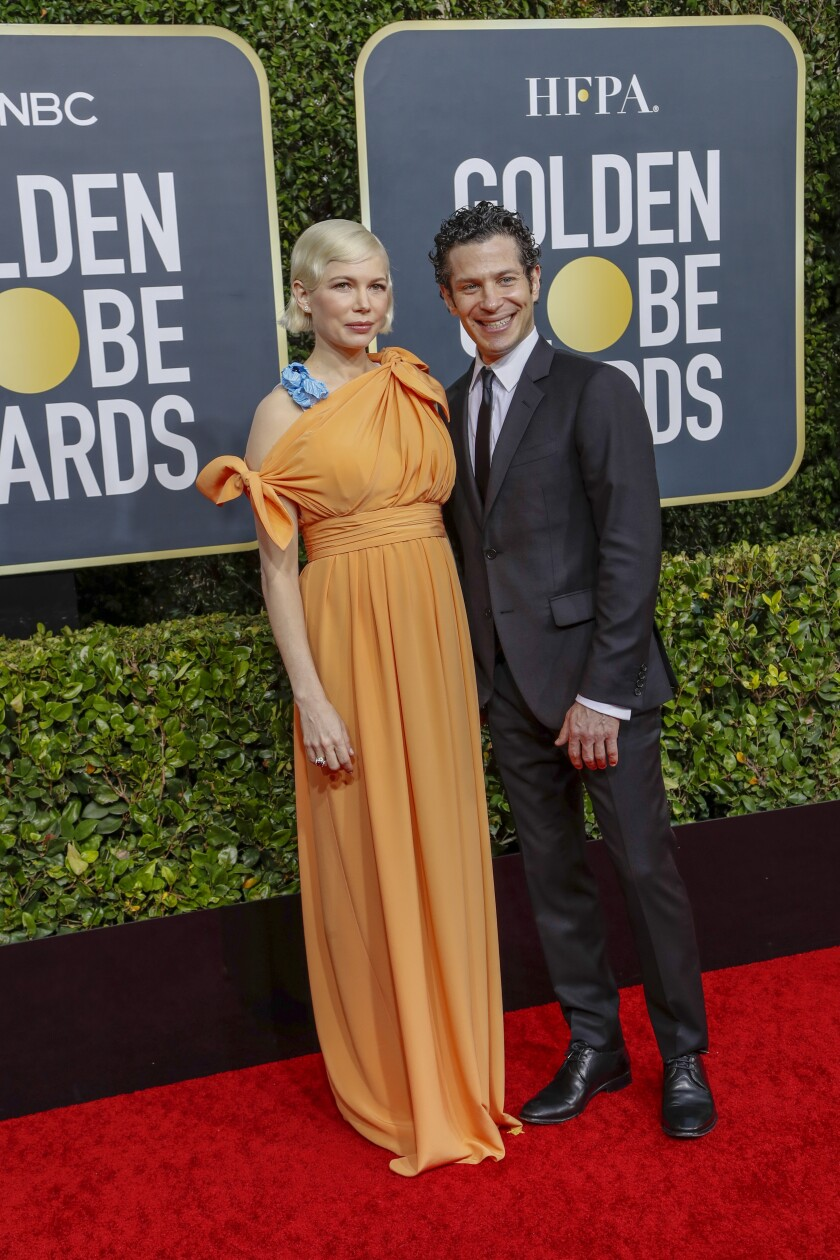 Michelle Williams and Thomas Kail at the Golden Globes