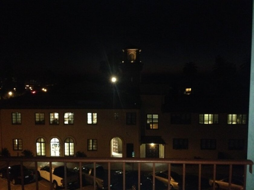 View of an offending light shining over St. James by-the-Sea episcopal Church, adjust the light Monday night, Oct. 27. u	as seen from the balcony of Wayne and mary Shuart's condominium.