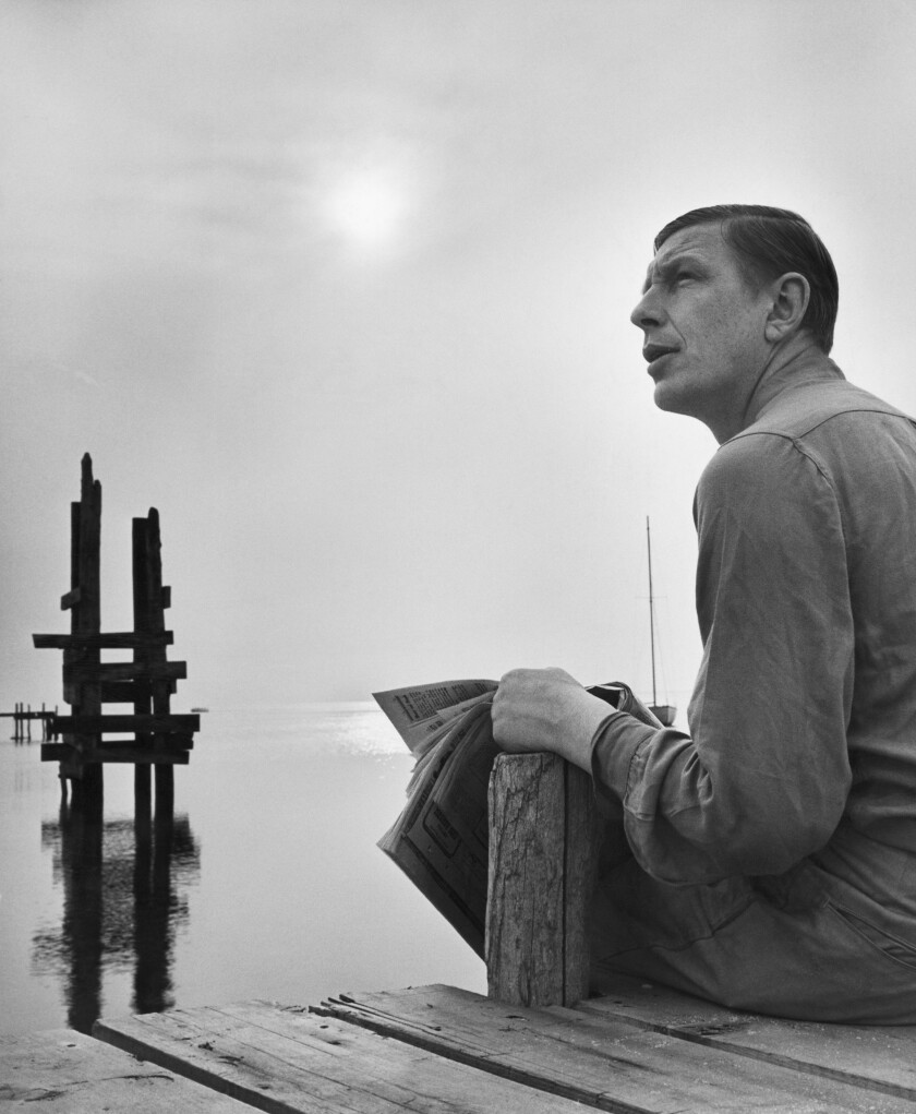 Poet W.H. Auden Sitting on a Dock