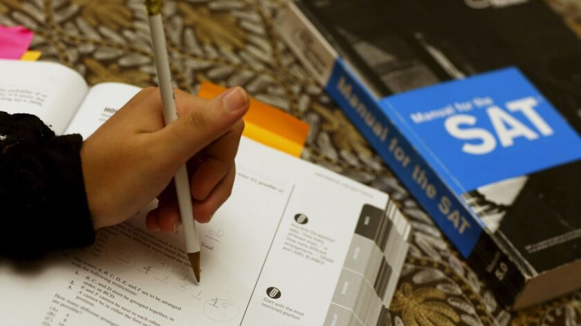 A college applicant uses an SAT preparation book to study for the test on March 6, 2014, in Pembroke Pines, Fla.