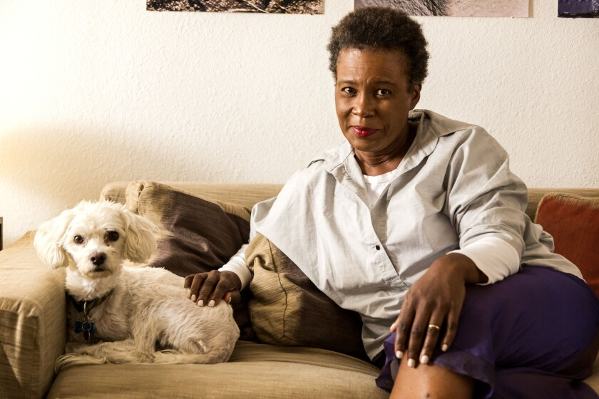 Poet Claudia Rankine, photographed at home with dog Sammy, has won the 2014 National Book Critics Circle Award for poetry.