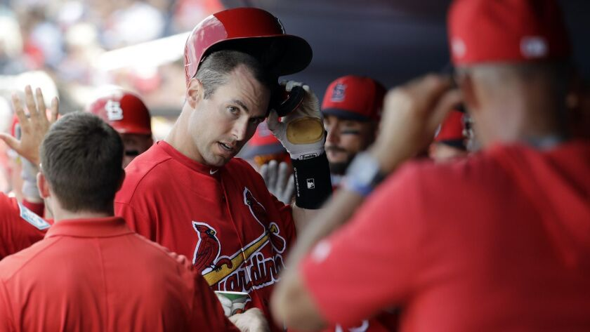 St. Louis Cardinals' Paul Goldschmidt is congratulated by teammates after scoring during the fourth