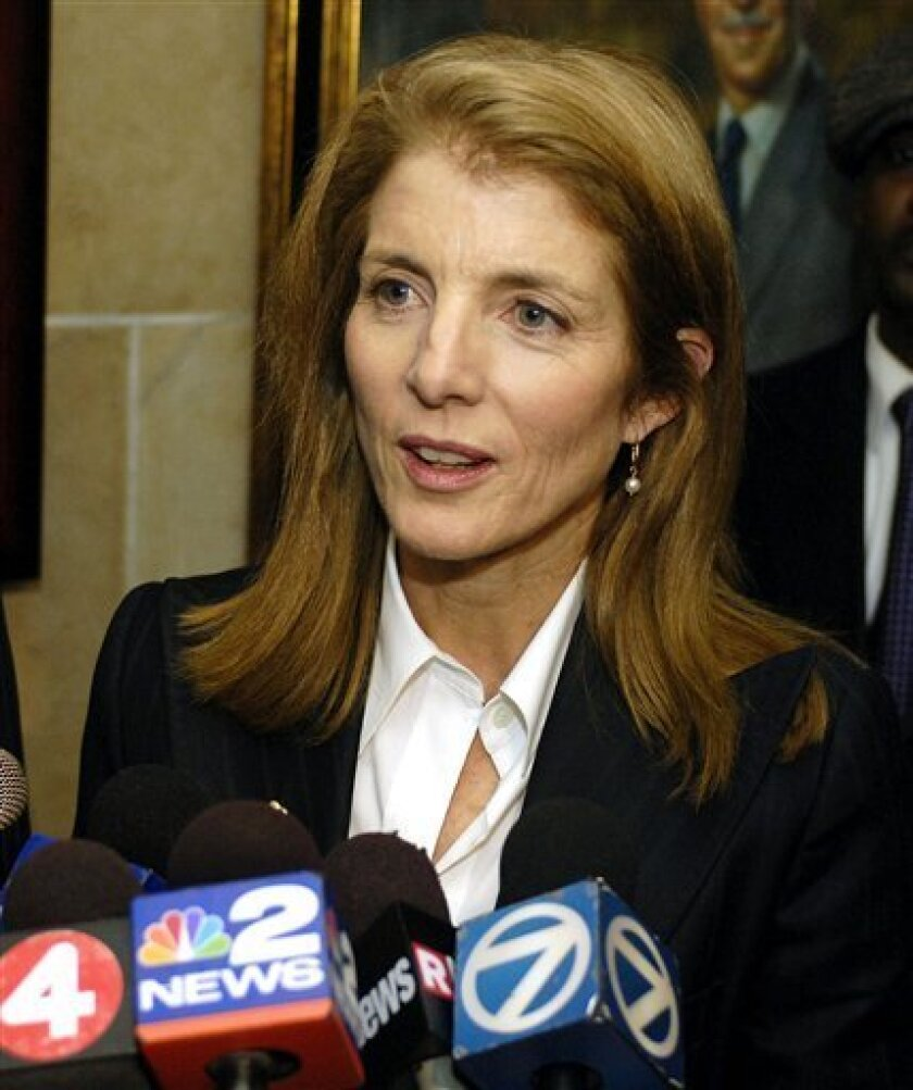 In this Dec. 17, 2008 file photo, Caroline Kennedy, daughter of former President John F. Kennedy, listens to a reporter's question during a news conference at City Hall in Buffalo, N.Y. As the governor considers a replacement for Sen. Hillary Rodham Clinton, Kennedy has one powerful factor in her