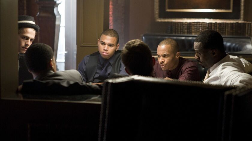 "(l to r) Hayden Christensen, Chris Brown, Tip ""T.I."" Harris and Idris Elba star in Screen Gems' acti"