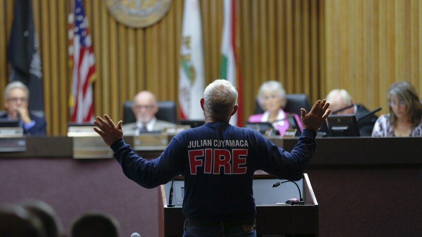 Ken Rice, a volunteer fire fighter, speaks to the commissioners at the San Diego LAFCO meeting held late Monday morning asking them to not move forward with dissolving the Julian Cuyamaca Fire Protection District.
