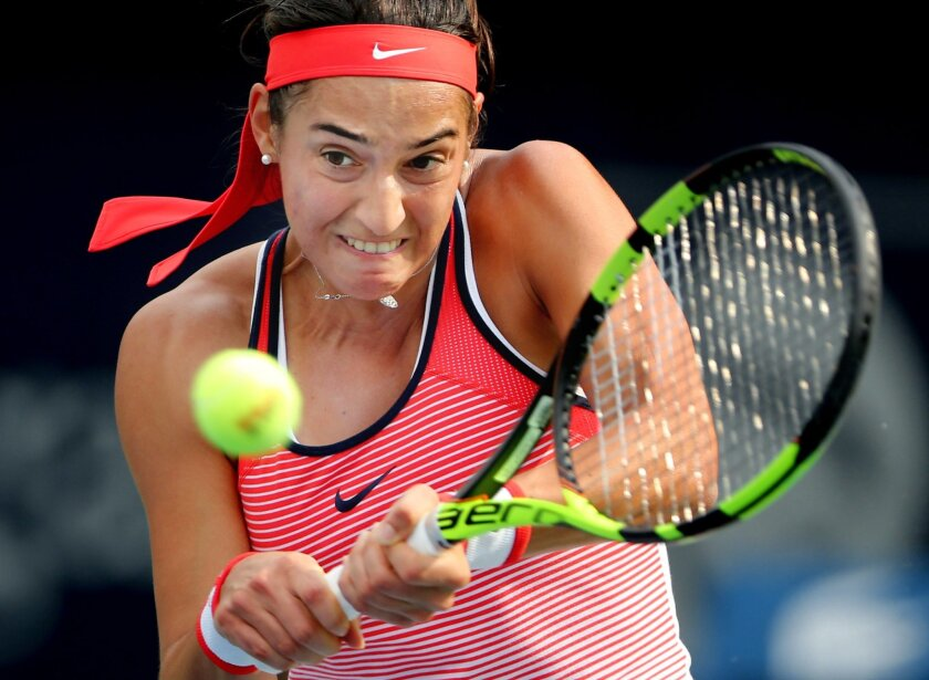 Caroline Garcia of France returns the ball to Carla Suarez Navarro from Spain during the third day of the Dubai Tennis Championships in Dubai, United Arab Emirates, Wednesday, Feb. 17, 2016. (AP Photo/Kamran Jebreili)