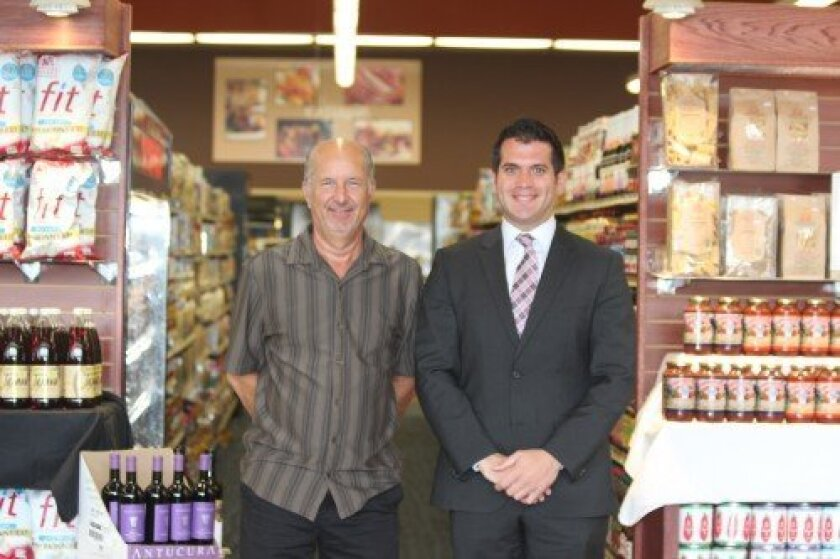 Al Bercuson, Jonathan's store manager, and Michael Dallo of Dallo Enterprises, bid adieu to the store's loyal customers. The gourmet market, which once included a live lobster tank near the front entrance, opened in 1970. It was purchased by the Dallo family in 1995.