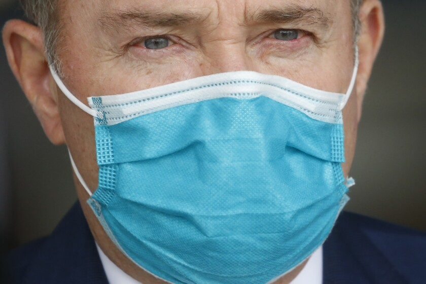 Utah Gov. Gary Herbert wears a mask during a news conference in Salt Lake City in April.