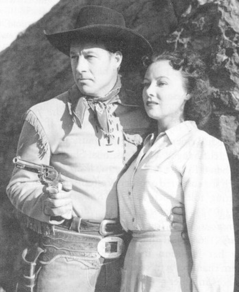 """Virginia Carroll starred with Bill Elliott, who played U.S. Marshal Wild Bill Hickok, in the 1942 film """"Prairie Gunsmoke."""" She was an L.A. department store model when she launched her acting career with a bit part in a 1935 movie."""