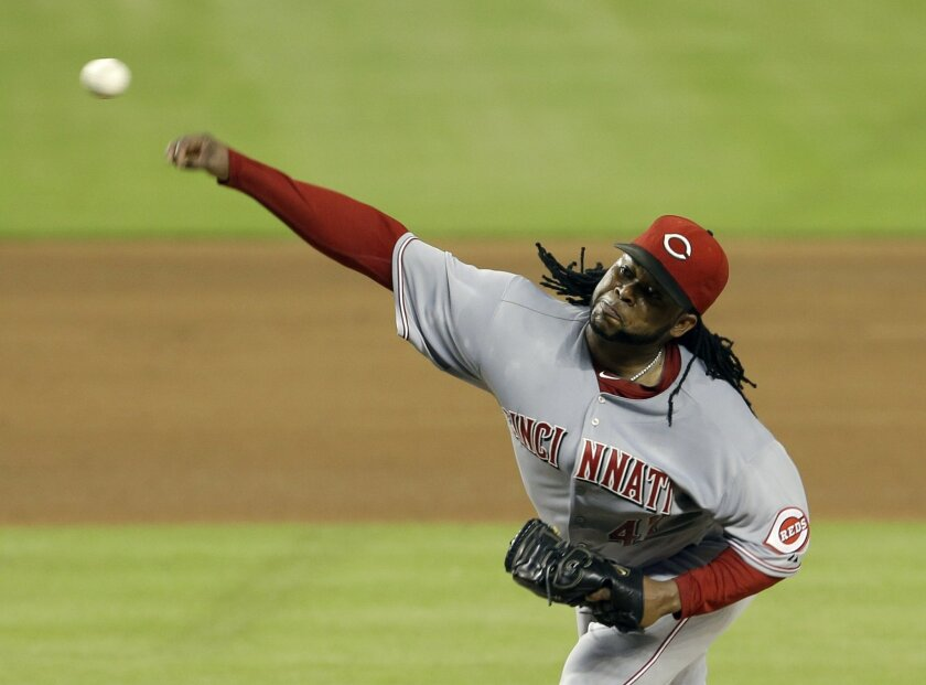 Cincinnati Reds' Johnny Cueto pitches against the Miami Marlins in the fourth inning of a baseball game in Miami, Thursday, July 31, 2014. (AP Photo/Alan Diaz)