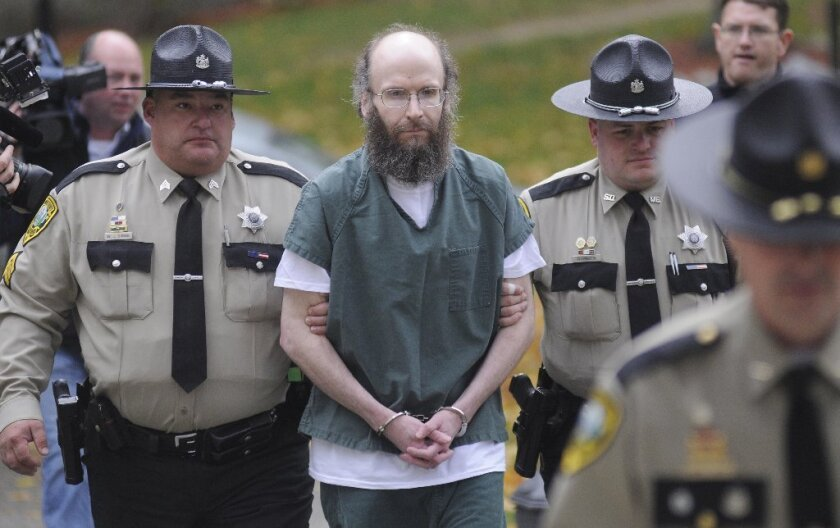 Christopher Knight is escorted into Kennebec County Superior Court in Augusta, Maine, where entered pleas for multiple burglaries and thefts while living in the woods of Rome, Maine, for 27 years.