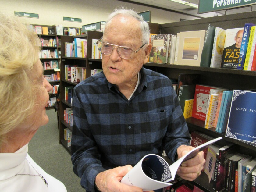 "Mount Helix resident Quentin T. Decker and his wife Betty, talk about his book of poetry and limericks at the Barnes & Noble bookstore in Grossmont Center. Decker, 90, is working on a follow-up to ""Love Poems,"" and said it would include some prose as well as more poetry."