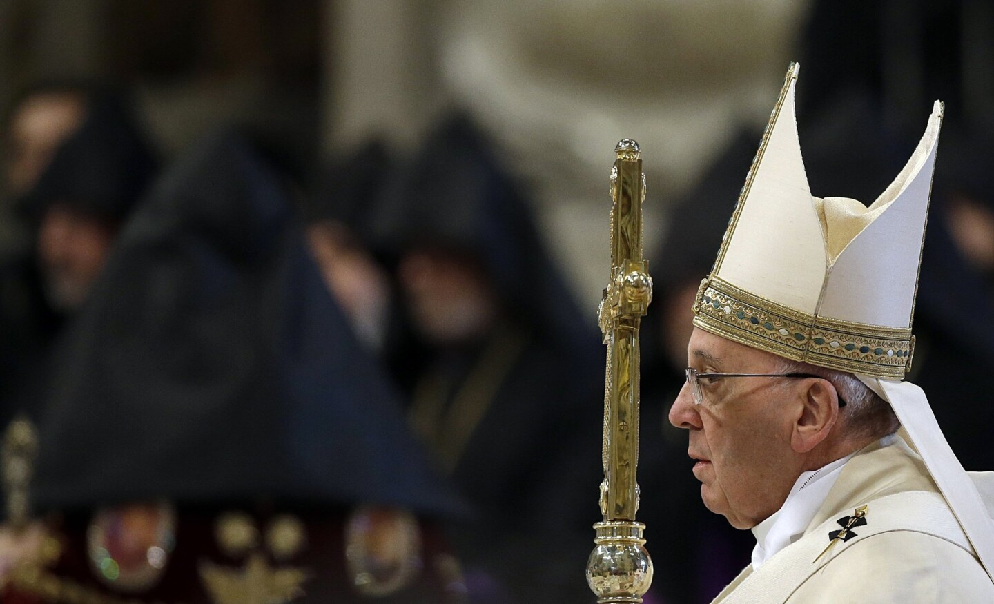 Pope Francis arrives in St. Peter's Basilica at the Vatican to preside over an Armenian rite Mass on April 12.
