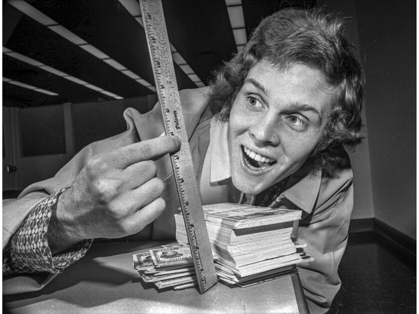 May 4, 1972: Jay North, 20, who played Dennis the Menace on the television series, measures his stack of savings bonds.